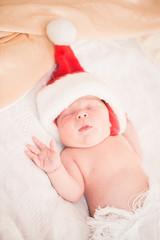 Infant boy in Santa hat
