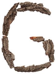 Alphabet from bark tree isolated on white background. Letter G