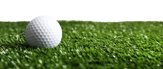 Golf ball on grass isolated on white