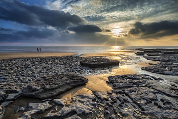 Stunning vibrant sunset landscape over Dunraven Bay in Wales Wall mural