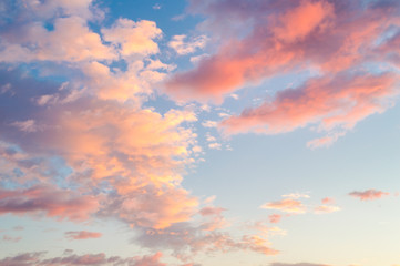 Sunset or dawn sky with pink and orange clouds