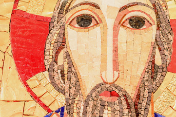 Detail of the face, eyes of Jesus Christ in mosaic