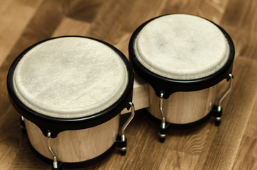 bongo drums at home wooden surface