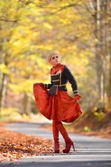 Beautiful elegant woman in autumn forest