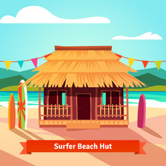 Surfers lagoon beach hut with standing surfboards
