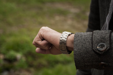 Closeup of watch and the hand
