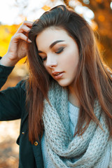 Close-up portrait of a young beautiful girl in knitted sweater,