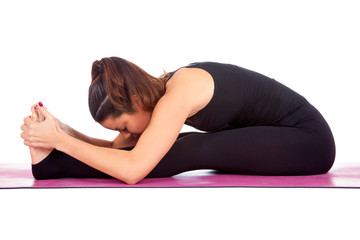 Beautiful woman doing Paschimottasana  pose
