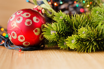 New year decoration on wood table with pine and red stars