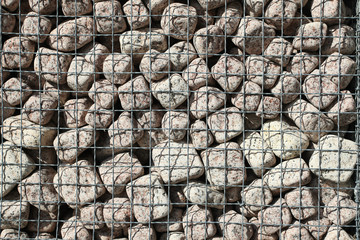 Granite cubes made of natural stone with a metal grid
