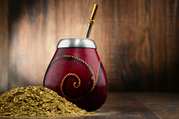 Composition with yerba mate cup and leaves