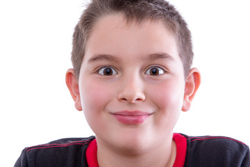 Young Wide Eyed Boy in Studio Smiling at Camera