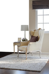 classic chair with brown pillow on carpet in vintage style inter