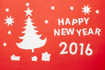 Applique with a New Year tree, cutted out of paper.