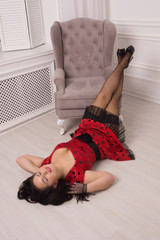 Pin-up girl lying on a floor