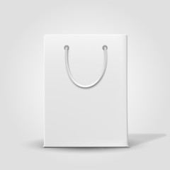 Shopping paper bag isolated on white. Vector