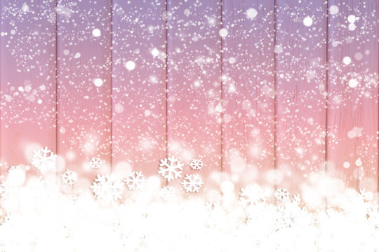 Snow on the wooden background