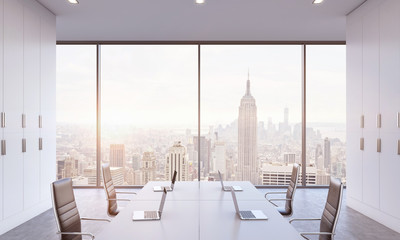 Workplaces or conference area in a bright modern open space office. White tables equipped by modern laptops and black chairs. New York view. 3D rendering. A sunset. Toned image.