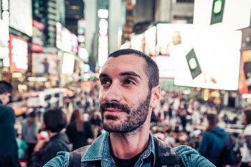 Backpacker tourist taking selfie in Time square, New york