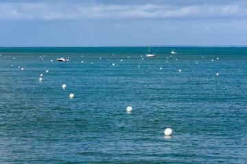 White buoys and boats