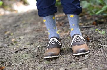 Young man's legs wearing polka dot socks
