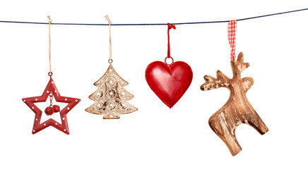 Vintage Christmas decorations hanging on string isolated