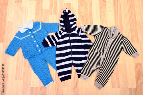 7001e3b20 Baby boy winter romper set lying on the floor. Child wool jumpsuits ...