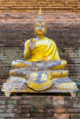 Old imgae of buddha on the chedi in public temple