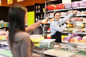 Shopkeeper serving a customer in a grocery store