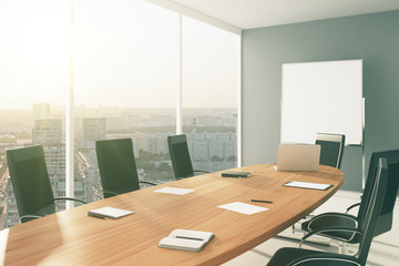 Light conference room with furniture, blackboard and city view