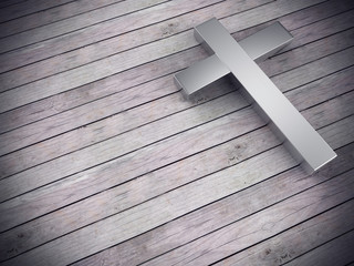 silver cross on wood background with clipping path