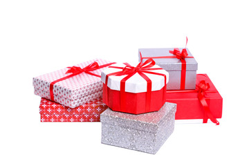 Gift boxes with xmas presents wrapped in red paper with ornament, isolated on white background