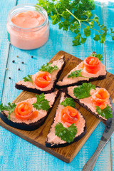 Sandwiches with red fish (salmon) in a rustic style