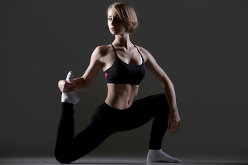 Fit woman doing low lunges