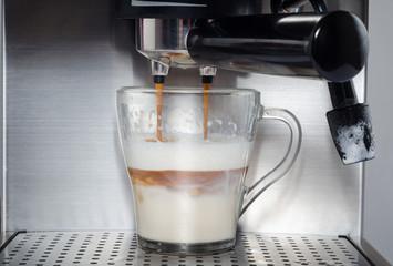 Cappuccino in coffee machine