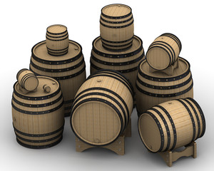 Wooden barrels of different sizes. Isolated on white surface