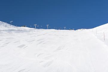 Snowy ski piste on a mountain