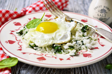 Rice with spinach and fried egg.