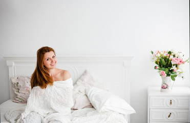 Young beautiful woman waking up fully rested