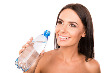 Happy cute girl holding a bottle with water