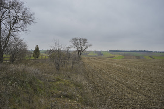 desolate landscape with ruins on a cloudy day