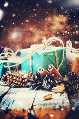 Festive Box with Pine cones on Wooden Background. Drawn Snow