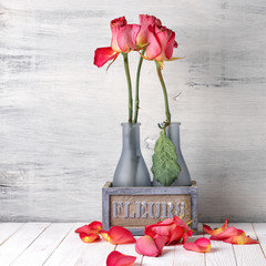 Wilted roses in vase