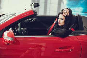 close up portrait of Young pretty brunette lady with a modern luxury car