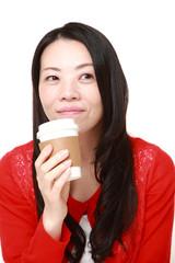 Japanese woman takes a coffee break
