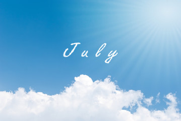 Blue sky background with july clouds word