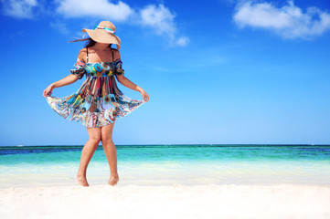 Young woman relaxing on exotic beach and enjoying the nice weath