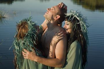 Love between men and two beautiful mermaids