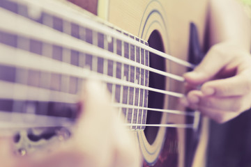 guitar player,Close up image of Musicians are playing on his acoustic bass guitars.