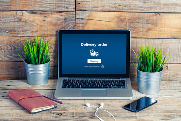 On line Delivery Order text in a laptop screen. Office.